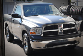 Ram truck service with tires on rack